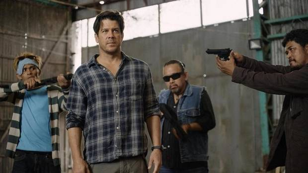 "Christian Kane, center, stars in the new series ""Almost Paradise,"" premiering Monday on WGN America. [Photo provided]"