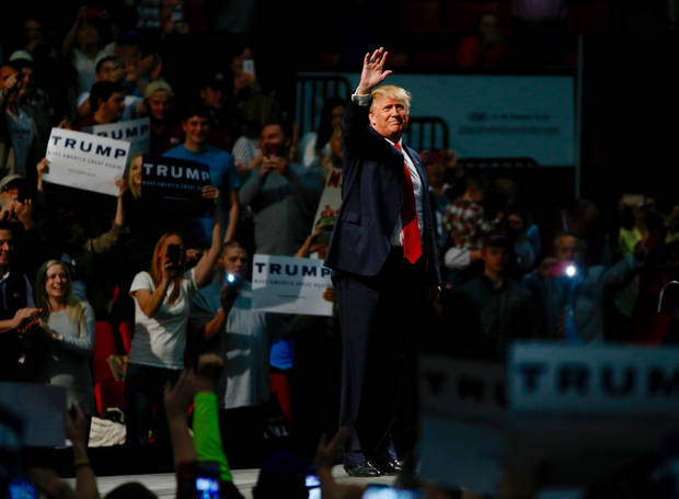 Donald Trump waves to the crowd during a rally Feb. 26, 2016 at the Cox Convention Center in Oklahoma City. [Photo by Bryan Terry, The Oklahoman]
