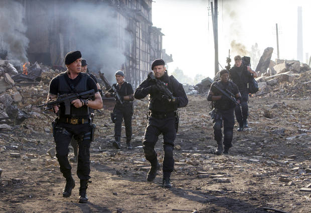 photo - This image released by Lionsgate shows Sylvester Stallone, left, and Jason Statham, center, in a scene from