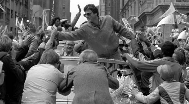 photo -                    St. Louis Cardinals catcher Darrell Porter reaches out to shake hands with the crowd during a victory parade through downtown St. Louis on Oct. 21, 1982. Porter was named the NLCS and World Series Most Valuable Player. The Cardinals beat the Brewers in seven games in the Series.                     AP Photo