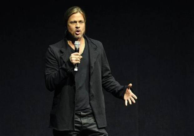 "photo - Brad Pitt, a cast member in the forthcoming film ""World War Z,"" introduces a clip from the film at CinemaCon 2013's Opening Night Presentation from Paramount Pictures at Caesars Palace on Tuesday, April 15, 2013 in Las Vegas. (Photo by Chris Pizzello/Invision/AP)"