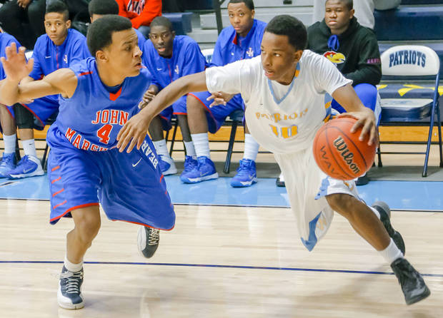 photo - Putnam City West's Marquis Johnson, right, drives past John Marshall's C.J. Smith during the Putnam City Invitational last week. Johnson averaged 10.7 points per game in the tournament, and had 13 points in the Patriots' win over top-ranked Tulsa Union. Photo by Chris Landsberger, The Oklahoman