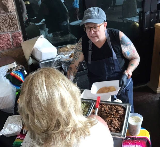 Chef Kathryn Mathis served Kimchi Brisket Tostadas at the Asian Food Fair. [Dave Cathey/The Oklahoman]