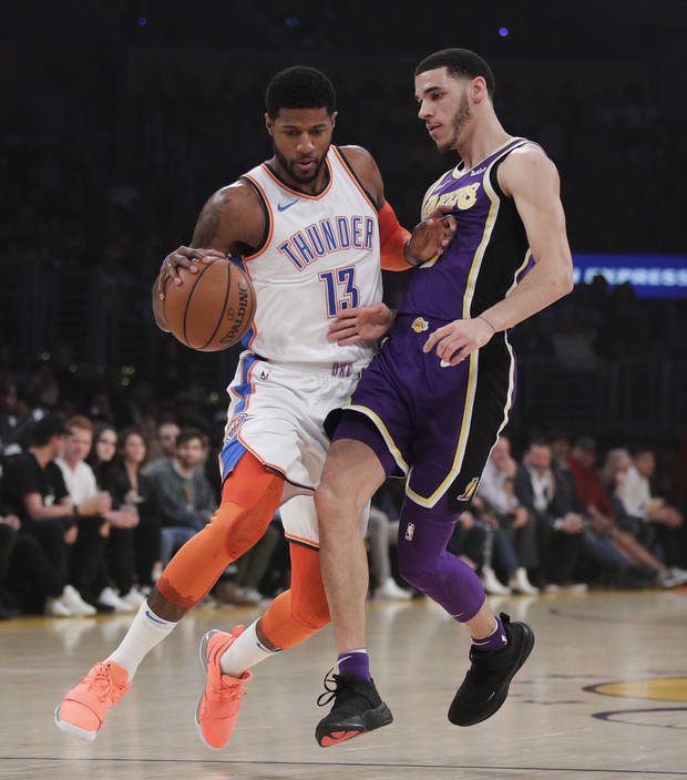 Oklahoma City Thunder's Paul George, left, is pressured by Los Angeles Lakers' Lonzo Ball during the first half of an NBA basketball game Wednesday, Jan. 2, 2019, in Los Angeles. (AP Photo/Jae C. Hong)