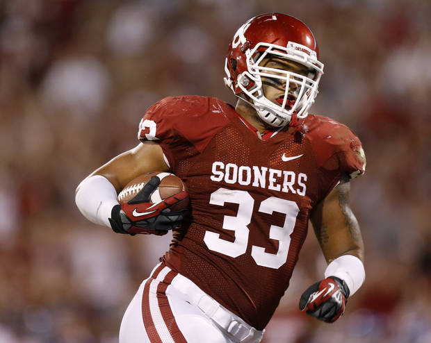 photo - OU's Trey Millard (33) catches a touchdown during the college football game between the University of Oklahoma Sooners (OU) and the Kansas Jayhawks (KU) at Gaylord Family-Oklahoma Memorial Stadium in Norman, Okla., Saturday, Oct. 20, 2012. Photo by Bryan Terry, The Oklahoman