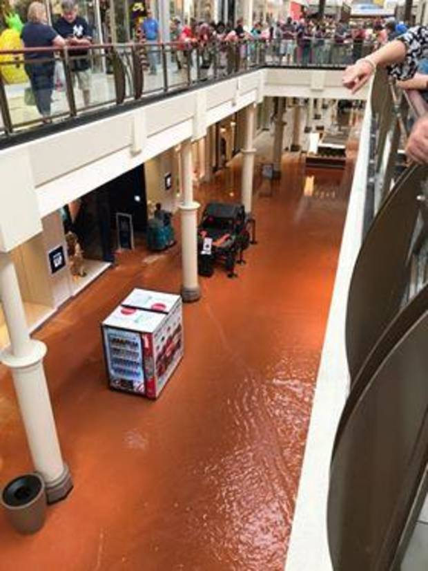 A water leak beneath Penn Square Mall has caused flooding on the mall's lower level. Photo courtesy of Colton Engelke.