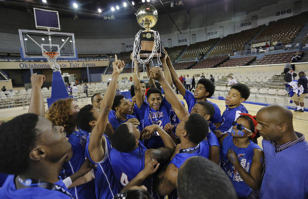 photo - Millwood celebrates with the gold ball trophy after the win over Okemah during the state high school basketball tournament Class 3A boys championship game between Millwood High School and Okemah High School at the State Fair Arena on Saturday, March 9, 2013, in Oklahoma City, Okla. Photo by Chris Landsberger, The Oklahoman
