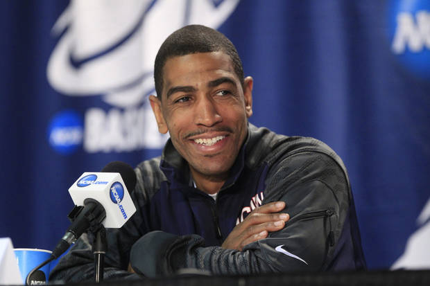 photo - Connecticut players Kevin Ollie speaks during a media session during the the men's NCAA college basketball tournament at First Niagara Center in Buffalo, N.Y., Friday, March 21, 2014.  (AP Photo/The Buffalo News, Harry Scull Jr.)