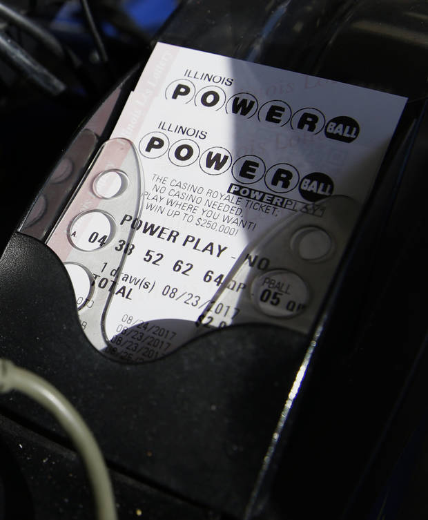 A Powerball lottery ticket is printed out of a lottery machine at a convenience store Wednesday in Northbrook, Ill. Lottery officials said the grand prize for Wednesday night's drawing has reached $700 million, the second-largest on record for any U.S. lottery game. (AP Photo/Nam Y. Huh)