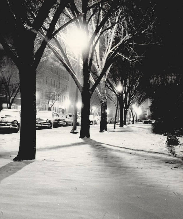 Dec. 29, 1958: Winter's touch transformed the Civic Center into a winter wonderland as crews were called out to sand slick sport and clear the snow off downtown streets. [Photo by Bob Albright]