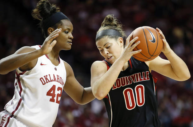 photo - Louisville's Sara Hammond (00) goes past Oklahoma's Kaylon Williams during the second half of an NCAA college basketball preseason WNIT championship game in Norman, Okla., Sunday, Nov. 17, 2013. Louisville won 97-92. (AP Photo/Bryan Terry)