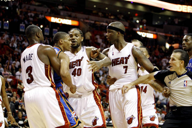 photo - Miami Heat players Dwyane Wade (3) and Udonis Haslem (40) try to restrain Oklahoma City  Thunder's Russell Westbrook (0) from Heat player Jermaine O'Neal (7) during a first half of an NBA basketball game in Miami, Tuesday, Nov. 17, 2009. (AP Photo/J Pat Carter)
