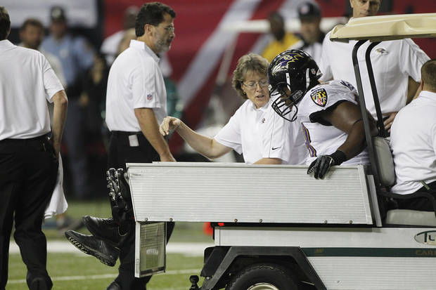 photo - Baltimore Ravens defensive end Ryan McBean (98) heads off the field after an injury during the first half of an NFL preseason football game against the Atlanta Falcons Thursday, Aug. 9, 2012, in Atlanta. (AP Photo/John Bazemore)