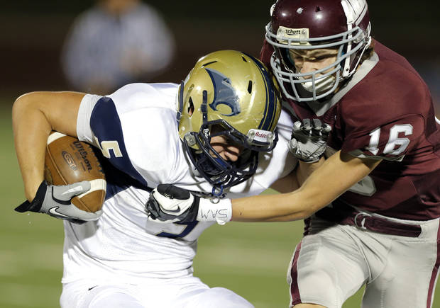 photo - Edmond Memorial's Tasden Ingram tackles Southmoore's Jackson Stallings during the high school football game between Edmond Memorial and Southmoore at Wantland Stadium in Edmond, Okla., Friday, Oct. 19, 2012. Photo by Sarah Phipps, The Oklahoman