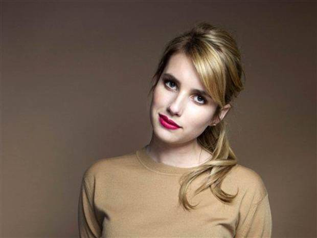 photo - This Oct. 19, 2012 photo shows American actress Emma Roberts posing for a portrait in New York. Roberts isn't just making a name for herself as a rising star in Hollywood. The 21-year-old routinely gets name-checked in magazines for her style on the red carpet. (Photo by Victoria Will/Invision/AP)