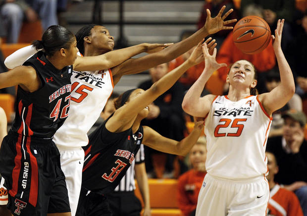 photo - Oklahoma State's Toni Young (15) and Lindsey Keller (25) try to rebound the ball against Texas Tech's Jackie Patterson (42) and Shauntal Nobles (33) during a women's college basketball game between Oklahoma State University (OSU) and Texas Tech at Gallagher-Iba Arena in Stillwater, Okla., Wednesday, Jan. 2, 2013. Photo by Nate Billings, The Oklahoman