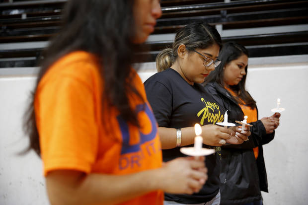 Amanda Sandoval, with Dream Action Oklahoma, bows her head for a prayer during a vigil to mark the one year anniversary of DACA rescission hosted by Dream Action Oklahoma at Sacred Heart Catholic Church in Oklahoma City, Wednesday, Sept. 5, 2018. Photo by Bryan Terry, The Oklahoman