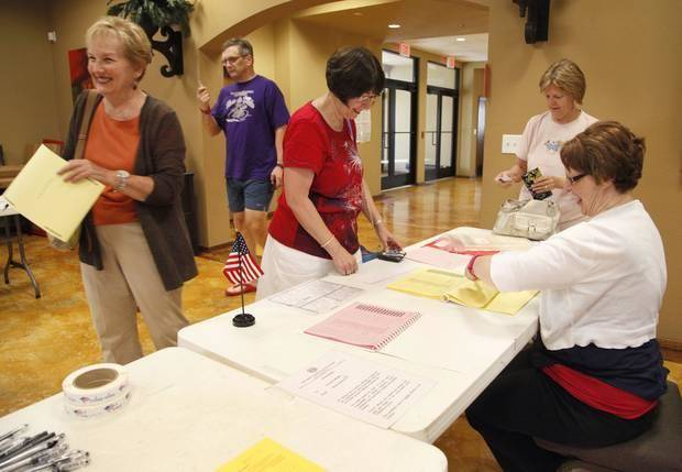 photo - Edmond citizens sign in to vote at the Spring Creek Assembly of God Church in Edmond, OK, Tuesday, June 24, 2014, Photo by Paul Hellstern, The Oklahoman