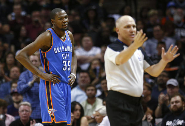 photo - Oklahoma City's Kevin Durant (35) looks towards an official during Game 2 of the Western Conference Finals in the NBA playoffs between the Oklahoma City Thunder and the San Antonio Spurs at the AT&T Center in San Antonio, Wednesday, May 21, 2014. Photo by Sarah Phipps, The Oklahoman