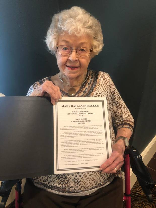 Mary Walker, who recently turned 100, displays a document welcoming her into the Centenarians of Oklahoma group.