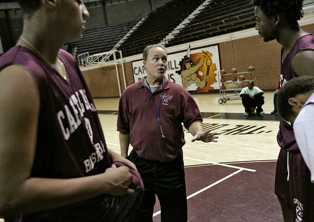 photo - Capitol Hill High School's head basketball coach Donny Tuley coaches his players at The Dome at Capitol Hill High School in Oklahoma City, Okla., Tuesday, Jan. 22, 2007. By John Clanton, The Oklahoman ORG XMIT: KOD