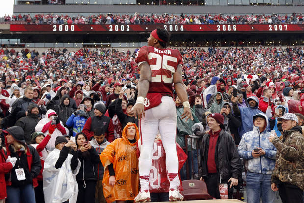 Joe Mixon celebrates with the crowd after OU's Bedlam victory on Dec. 3. (Photo by Steve Sisney)