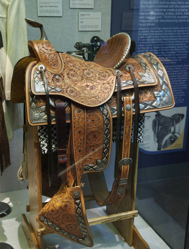 "<p>This Oklahoma Centennial saddle is part of the Oklahoma History Center's ""Crossroads of Commerce: A History of Free Enterprise in Oklahoma,"" and tells part of the story of how cowboy culture has helped grow the state's economy. [Photo by Paul Hellstern, The Oklahoman]</p>"