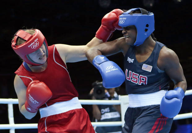 photo - Kazakhstan's Marina Volnova, left, fights United States' Claressa Shields during their middleweight 75-kg semifinal boxing match at the 2012 Summer Olympics, Wednesday, Aug. 8, 2012, in London.(AP Photo/Ivan Sekretarev) ORG XMIT: OBOX125