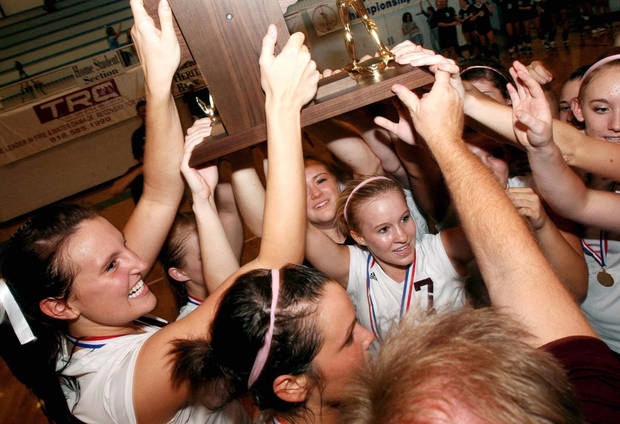 photo - Edmond Memorial players celebrate their win over Edmond Santa Fe in the Class 6A volleyball championship game at Sapulpa High School on Oct. 13, 2007.  PHOTO BY JAMES GIBBARD, Tulsa World