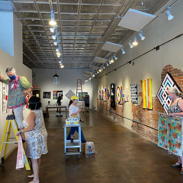 "Members of the Oklahoma artist collaboration Qu'aint install the collective's ""Convergence"" exhibit at The Vault Art Space and Gathering Place in Pauls Valley. [Photo provided]"