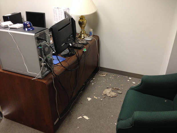 photo -  Pieces of concrete sit on the floor in an office at the state Capitol on Monday. The pieces apparently fell through a ceiling tile into the basement office over the weekend. PHOTO PROVIDED