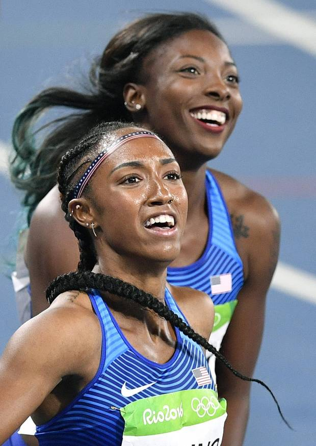 Brianna Rollins from the United States, front, celebrates winning the gold medal in the women's 100-meter hurdles final with silver medal winner United States' Nia Ali during the athletics competitions of the 2016 Summer Olympics at the Olympic stadium in Rio de Janeiro, Brazil. (AP Photo/Martin Meissner)