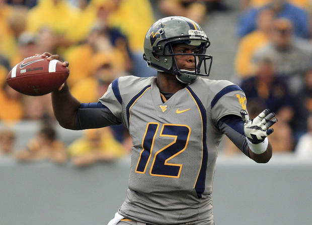 photo - West Virginia quaterback Geno Smith (12) goes to pass during their NCAA college football against Maryland in Morgantown, W.Va. Saturday, Sept. 22, 2012. (AP Photo/Christopher Jackson) ORG XMIT: WVCJ106
