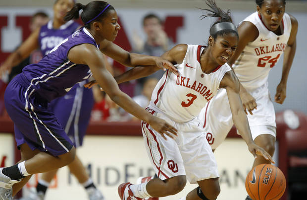photo - OU: Oklahoma's Aaryn Ellenberg (3) tries to control the ball beside TCU's Zahna Medley (14) during a women's college basketball game between the University of Oklahoma and TCU at the Lloyd Noble Center in Norman, Okla., Wednesday, Jan. 30, 2013. Oklahoma won 74-53. Photo by Bryan Terry, The OklahomanOU: