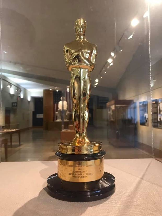 "John Wayne's best actor Oscar for ""True Grit"" is displayed in the National Cowboy & Western Heritage Museum's exhibit ""Two Grits- A Peek Behind the Eyepatch,"" which explores the two different films made from the 1968 novel ""True Grit"" by Charles Portis. [Photo provided]"