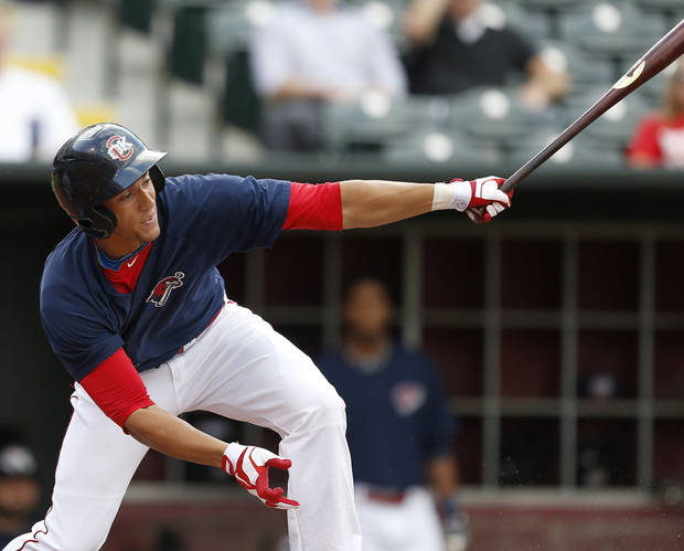 photo - George Springer of the Oklahoma City RedHawks looks up as he drives a run in against the Iowa Cubs in the first inning of their baseball game at Chickasaw Bricktown Ballpark in Oklahoma City, Friday, July 26, 2013. Photo by Bryan Terry, The Oklahoman