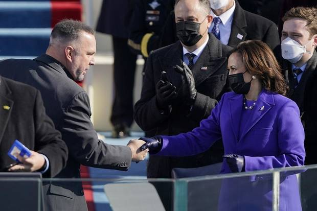 "Garth Brooks shakes Vice President Kamala Harris' hand after singing ""Amazing Grace"" during the 59th Presidential Inauguration at the U.S. Capitol in Washington, Wednesday, Jan. 20, 2021. [AP Photo/Patrick Semansky, Pool]"