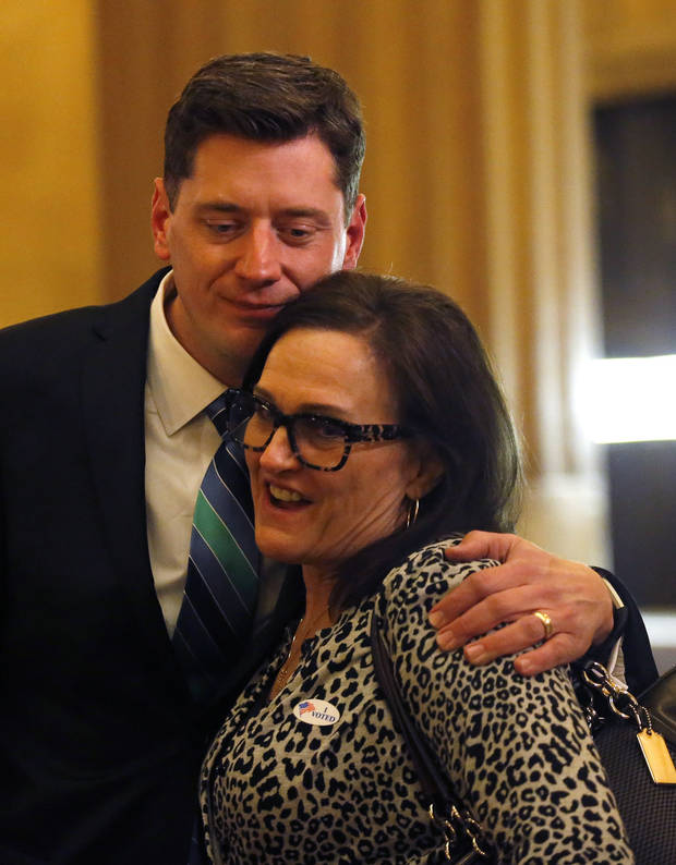 David Holt hugged his former teacher Diane Welker at his election night watch party at First National Center in downtown Oklahoma City on Feb. 13. [Photo by Sarah Phipps, The Oklahoman]