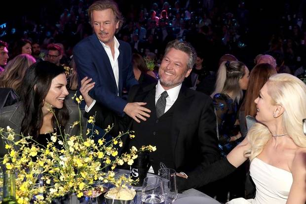 From left, David Spade, Blake Shelton and Gwen Stefani appear during the 2019 E! People's Choice Awards at the Barker Hangar on November 10, 2019. [Photo by Christopher Polk/E! Entertainment]