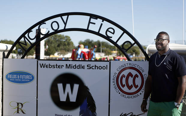 photo - Gerald McCoy stands next to a sign at the new athletic fields at Webster Middle School, Sunday, Oct. 6, 2013, in Oklahoma City. Photo by Sarah Phipps, The Oklahoman