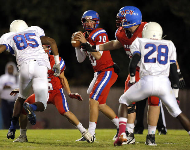 photo - OCS' Chris Cohn looks to throw the ball during the high school football game between Oklahoma Christian and Millwood at Oklahoma Christian Schools in Edmond, Okla.,  Friday, Oct. 5, 2012. Photo by Sarah Phipps, The Oklahoman