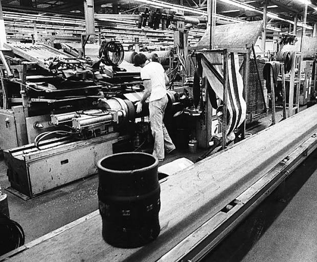 photo - A worker at the Dayton Tire plant in Oklahoma City is shown in this photo from April 1980.   - PHOTO BY DAVID MCDANIEL, THE OKLAHOMAN