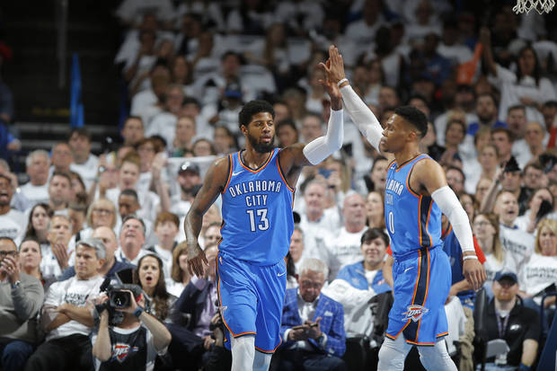 Oklahoma City's Paul George (13) celebrates with City's Russell Westbrook (0) during Game 5 of the first round NBA playoff series between the Oklahoma City Thunder and the Utah Jazz at Chesapeake Energy Arena in Oklahoma City, Wednesday, April 25, 2018. Utah won 102-95. Photo by Bryan Terry, The Oklahoman
