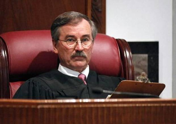 photo - Judge Ray Elliott conducts a hearing on a request for him to step down from the trial of pharmacist Jerome Ersland at the Oklahoma County Courthouse in Oklahoma City, OK, Monday, Dec. 6, 2010. By Paul Hellstern, The Oklahoman