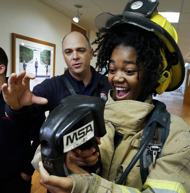 Mid-Del student Kelli Harrell gets help using a thermal imaging camera from Capt. Marty Harrison during a mentorship program on Thursday, Nov. 16, 2017 in Del City, Okla. Photo by Steve Sisney, The Oklahoman