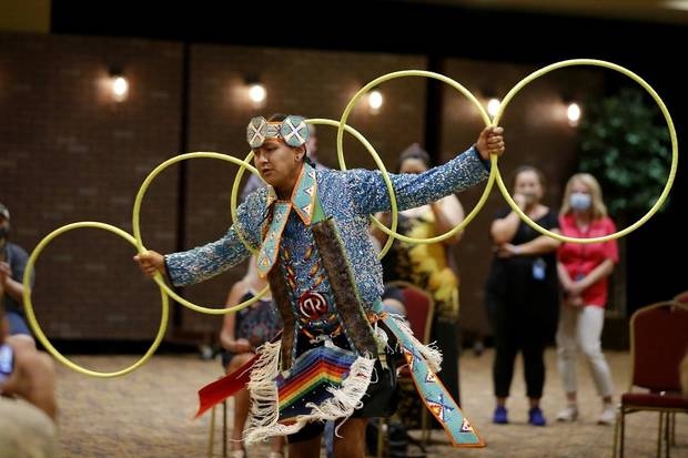 Jace Roberts, who is Choctaw and Nakoda, performs a hoop dance during a dance exhibition by the Central Plains Dancers at the Red Earth Festival at Grand Event Center at the Grand Casino Hotel & Resort, Saturday, Sept. 5, 2020. [Bryan Terry/The Oklahoman]