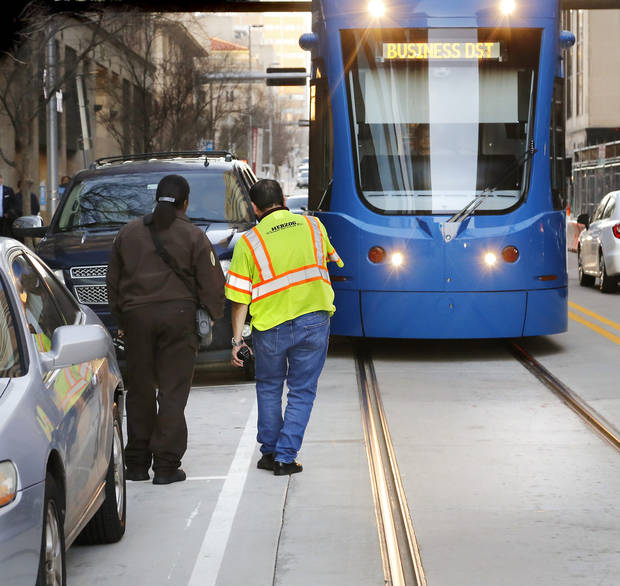 Streetcar system managers say enhanced pavement markings have reduced instances of parked cars blocking the tracks. [Photo by Jim Beckel/The Oklahoman]