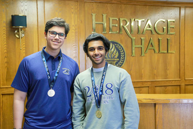 Policy debaters Saif Salim (sophomore) and Vyas Venkataraman (senior) went on a 7-0 run to secure the OSSAA 6A state championship. [PHOTO PROVIDED]