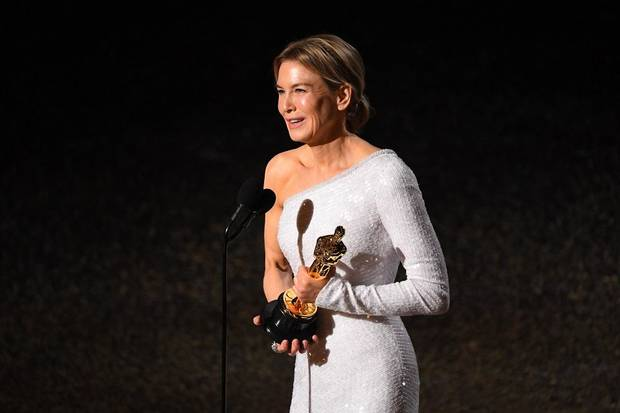 "Renee Zellweger accepts the award for best performance by an actress in a leading role for her role in ""Judy"" during the 92nd Academy Awards at Dolby Theatre. [Robert Deutsch/USA TODAY]"