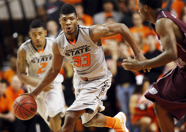 photo - OSU's Marcus Smart (33) dribbles the ball during a men's college basketball between Oklahoma State University and Missouri State at Gallagher-Iba Arena in Stillwater, Okla., Saturday, Dec. 8, 2012. Photo by Nate Billings, The Oklahoman